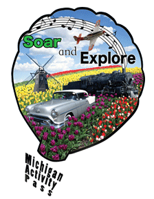 Hot air balloon with classic car, tulips, and windmill