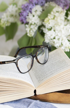 glasses on top of book book cover