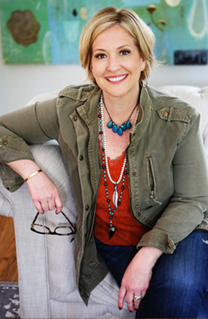 Brene Brown sitting on couch