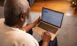 Older gentleman looking at laptop
